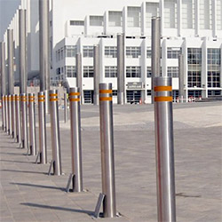 A picture of some stainless steel retractable bollards.